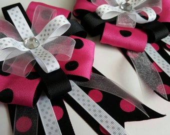 Horse show bows in pink and black polka-dot print with sheer ribbon trim and crystal center