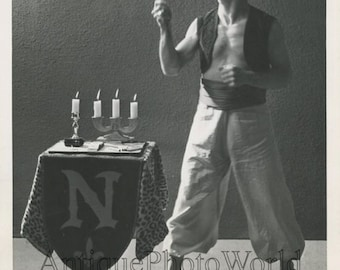 Fire eater circus performer magician by candles fun vintage photo