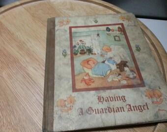 Having a guardian angel, small thin hardback book, Cecily Hallack, illustrated by Ida Bohatta Morpurgo. Burns Oates