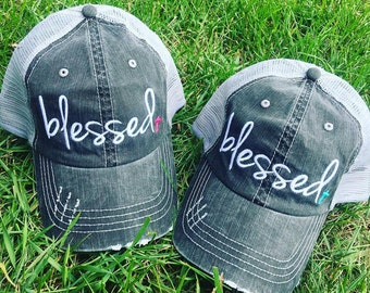 Hat {Blessed} Pink or teal cross. 2.98 US ship. 10 Worldwide ship.