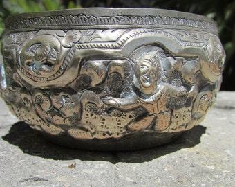 Silver Tin Metal Indian or Burmese Storyteller repousse bowl with praying Buddha