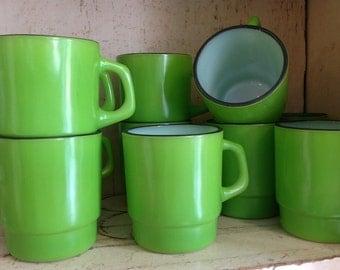 Ten matching lime green black rim Fire King mugs
