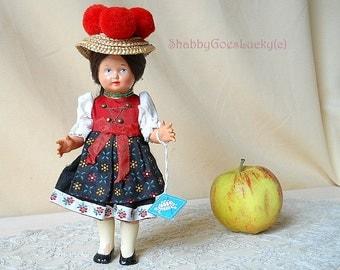 German vintage Black Forest Schwarzwald souvenir doll, made of celluloid, costume doll with turtle mark, Bollenhut – hat & original costume