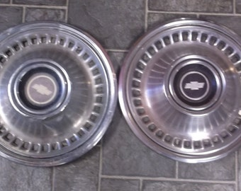 Pair of Vintage Chevy Hubcaps