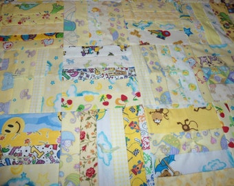 Baby Quilt, made with log cabin pattern in yellow.