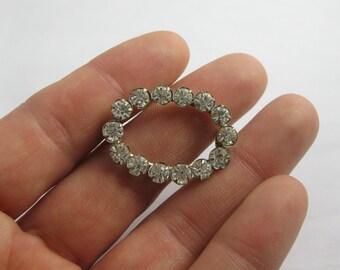 Elegant, age old rhinestone brooch. Fashion jewelry. Vintage
