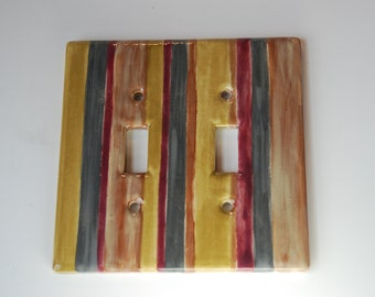 Multi color striped ceramic double switch plate.Yellow, wine, brown stripes can match many types decor.