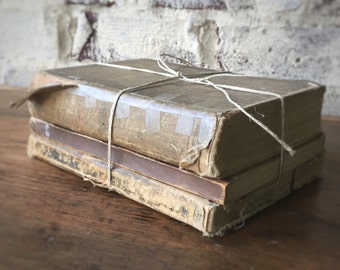 Vintage book stack in browns/neutrals