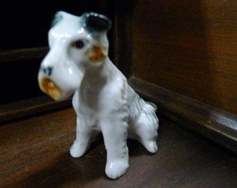 Vintage sitting ceramic terrier dog figurine