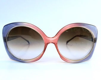 Sassy 1970s two tone blue and pink oversized sunglasses with smoky grey gradating lenses