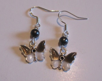 Handmade black and white enameled butterfly earrings