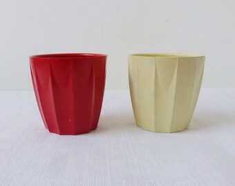 2 vintage Bakelite egg cups, red and cream ribbed N B Ware, 1950s plastic