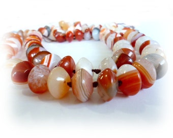 Brownish Orange Stripped Agate Beads_CP03520446310_GEMS_Stripped Agate of 10x14 hole 1 mm_Strand 35 bead