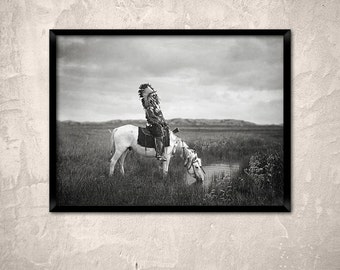Native American photography, 1905. An oasis in the Badlands.Lakota Sioux - Red Hawk - on horse drinking at oasis. Native American art print.
