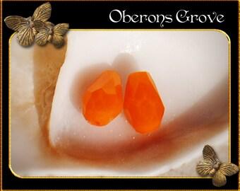 10 orange coloured tear drop beads 4x6mm