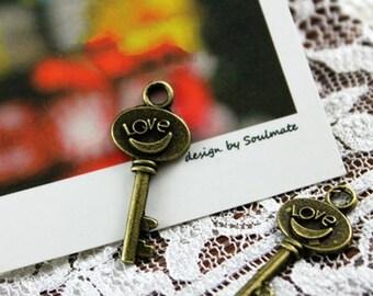 "20 pcs of antique bronze ""love"" key charm pendant 30mm"
