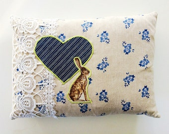 Handmade cushion using applique heart and hare motif and vintage lace  with feather inner