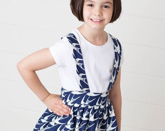 Navy bird suspender skirt
