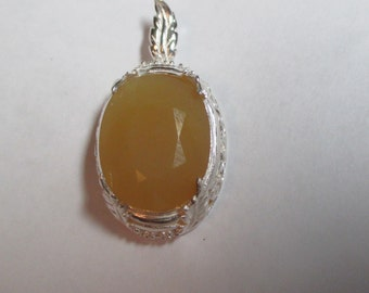 Huge golden fire opal with rubies in sterling silver hand made mounting