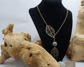 Leave: necklace lasso boho unbalanced color bronze, sheets and bead color aqua resin