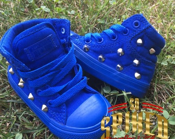 All blue converse with studs