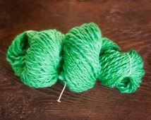 Merino wool spun by hand, emerald green and forest green. Two ply yarn, soft yarn