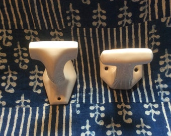 2 white porcelain coat pegs
