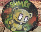 "Acrylic painting of Shmee on 12"" vinyl LP"