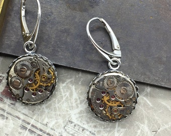Sterling Silver steampunk earrings.   Jeweled mechanical watch movements. artistically designed steam punk jewelry by the Victorian Magpie