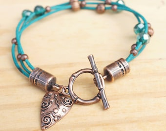 Turquoise bracelet with copper and glass beads