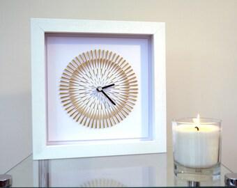 Lunar Eclipse. Gold hand cut paper clock