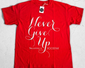 Never Give Up Becoming a Rockstar - Red t-shirt