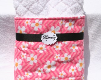 Pink and white floral baby blanket with white soft and fluffy fabric on the reverse