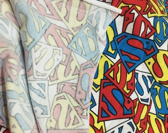 Colourful superman logo knit cotton fabric
