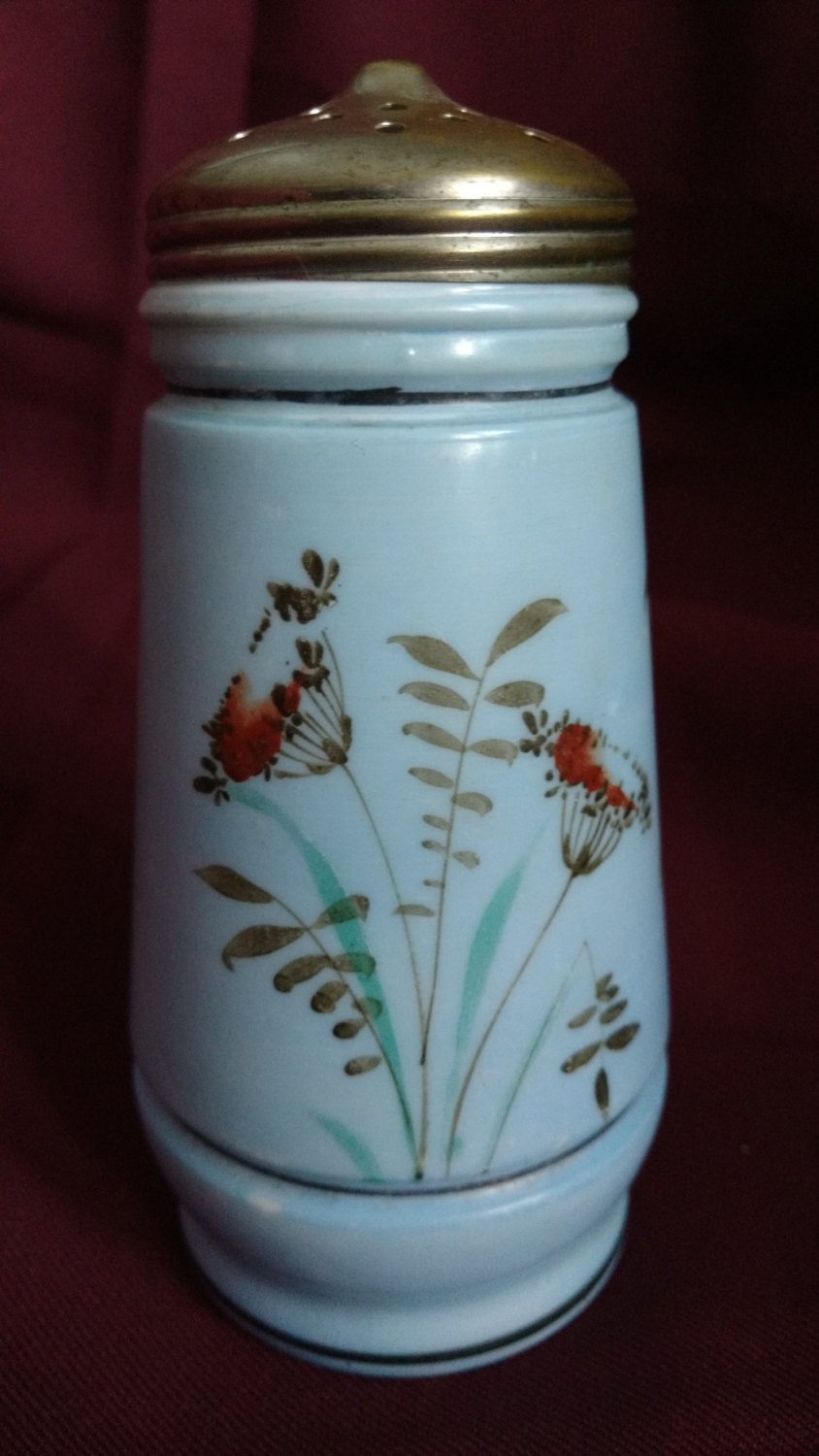 Vintage sugar shaker and ennobled