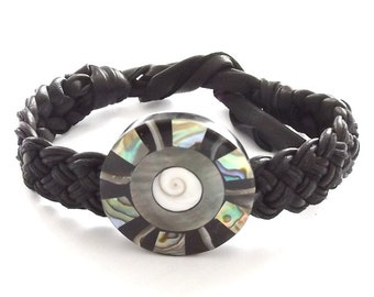 Black leather and abalone shell tie on friendship bracelet. Round disc pearl design.