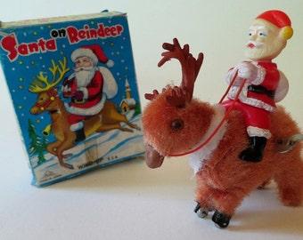 Vintage Wind Up Santa on Reindeer