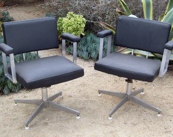 Pair of mid century Goodform swivel chairs