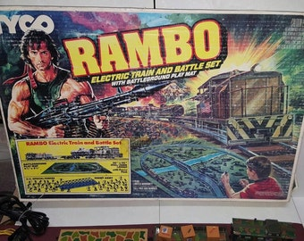 RESERVED for heatherdewsy - Tyco Train Set, Rambo Electronic Train & Battle Set w/Battleground Play Mat, 80's Hollywood Action Figure Icon