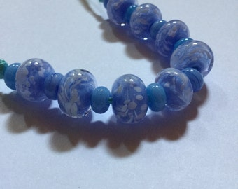 Baby blues Encased In Clear Glass Lampwork Beads