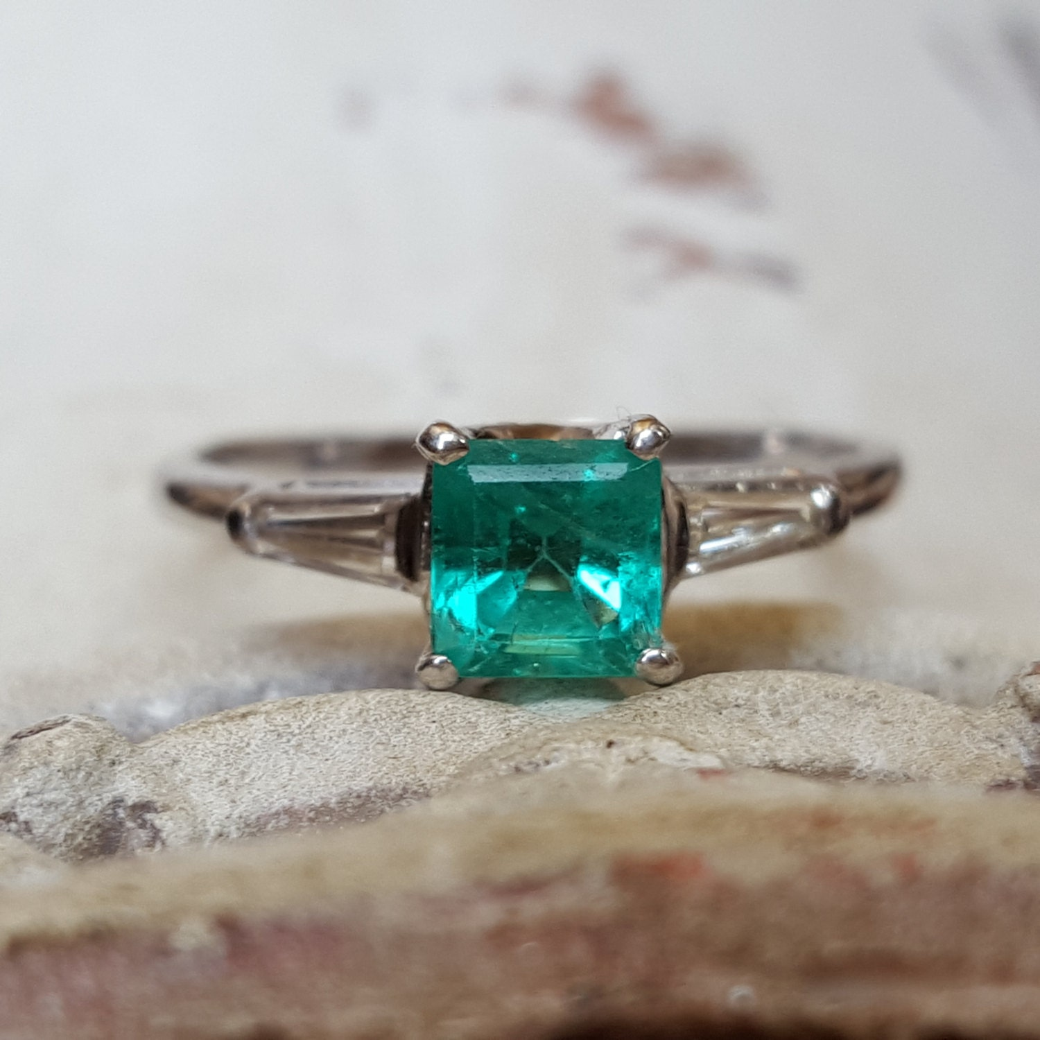 vintage emerald and baguette engagement ring in 14k