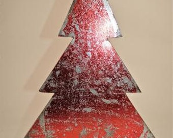 A beautiful 3D red distressed tin free-standing Christmas tree decoration