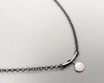 dot and bar with  bigger disc, thicker chain