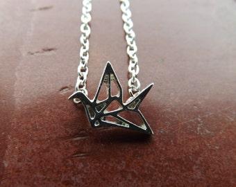 Origami style crane necklace.