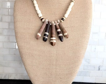 See urchin and bone beaded necklace