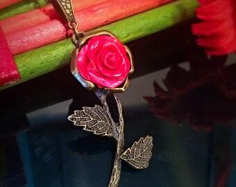 Red rose on bronze pendant