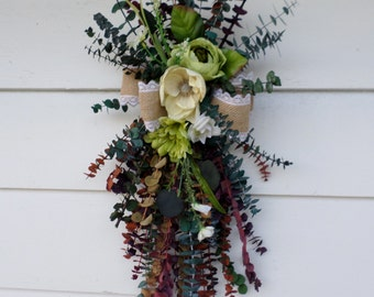 Summer Eucalyptus Door Swag! This Dried Floral Swag is accented with a Burlap Bow.