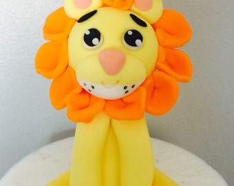 Lion baby shower cake topper made from gum paste