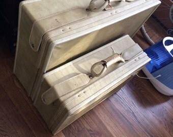 Vintage tan Hartmann luggage