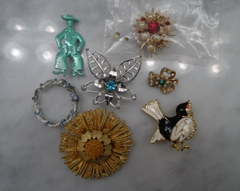 Lot of  7 1950's and up vintage brooches and pins,  bird, sunburst